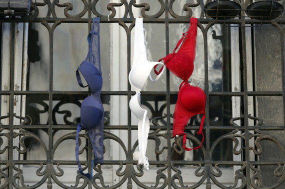 Blue, white and red brassieres, the colours of the French national flag, hang from a balcony in Marseille